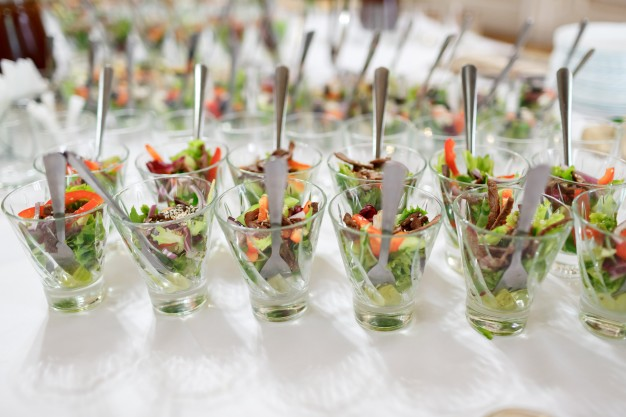 glasses-with-salad-served-on-white-table_1304-4672